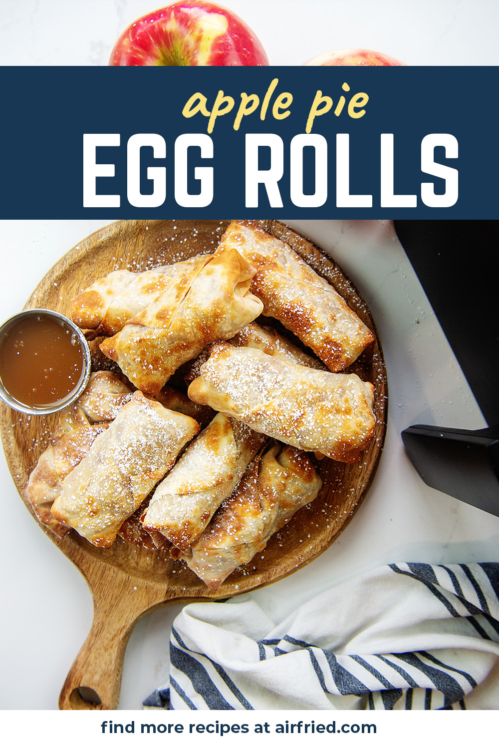 Overhead view of egg rolls and caramel on a wooden plate