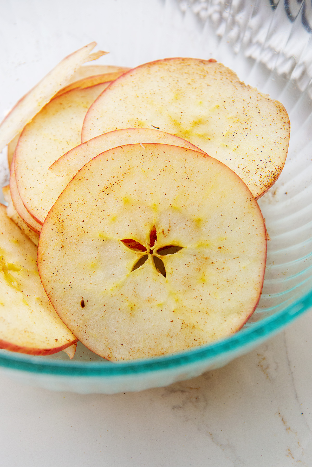 Apple slices in a clear glass bowl