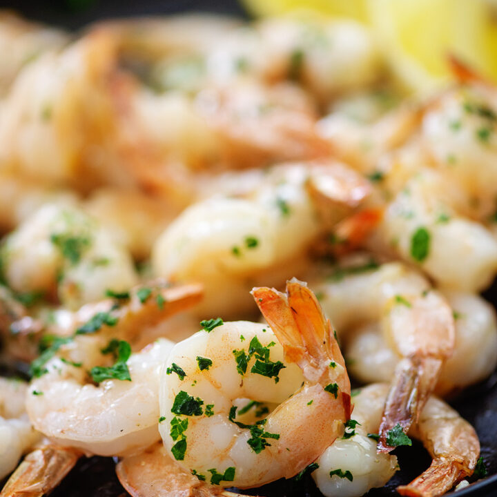 cooked shrimp with parsley on plate.