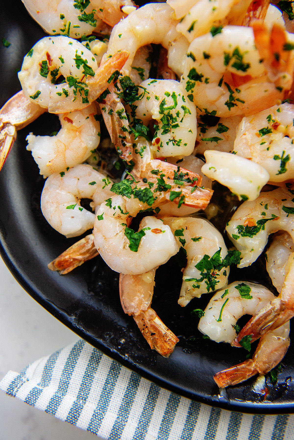 cooked shrimp on black plate.