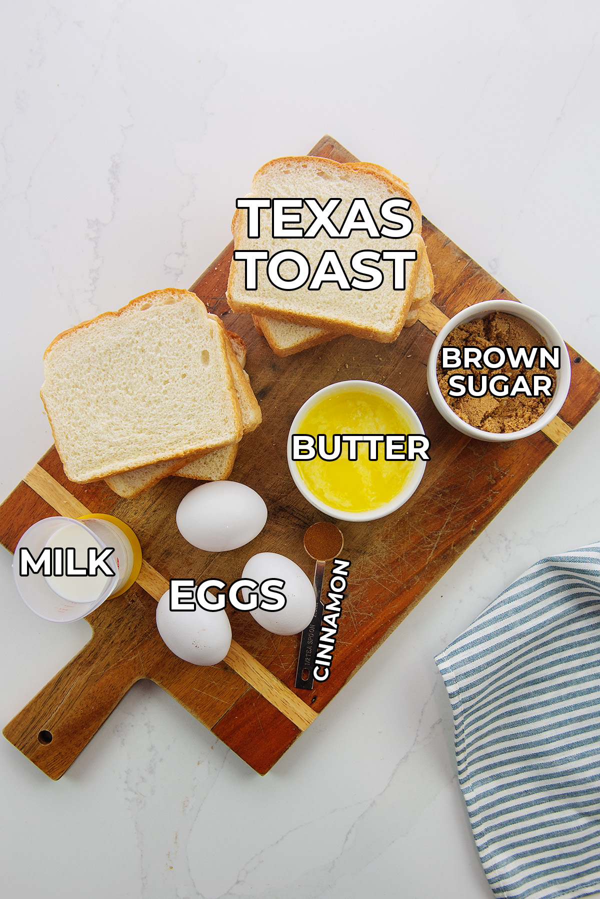 French toast ingredients spread out on a cutting board.