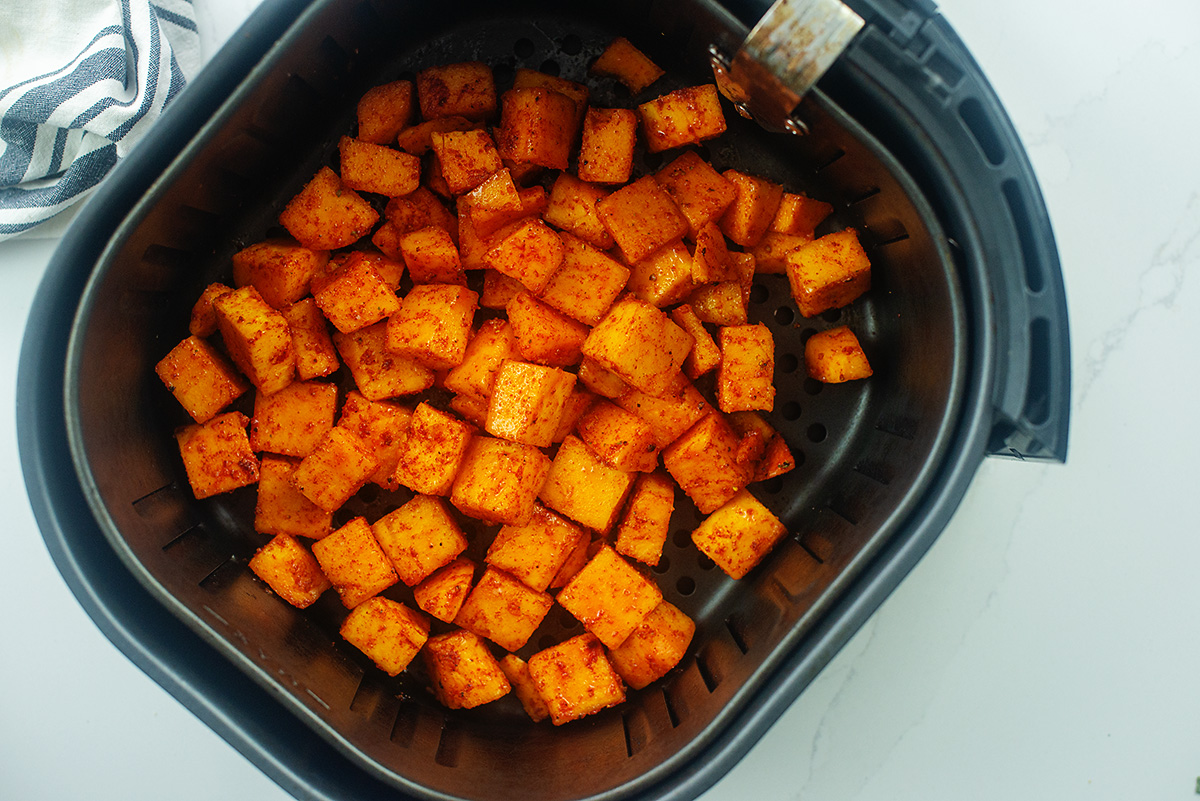 Overhead view of cooked cubes of butternut squash