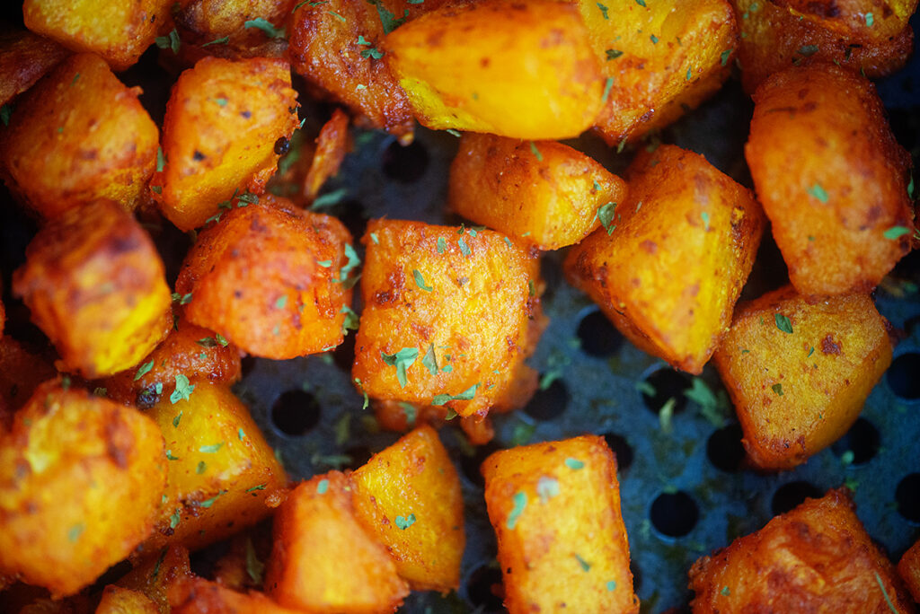 Close up of cooked cubes of butternut squash