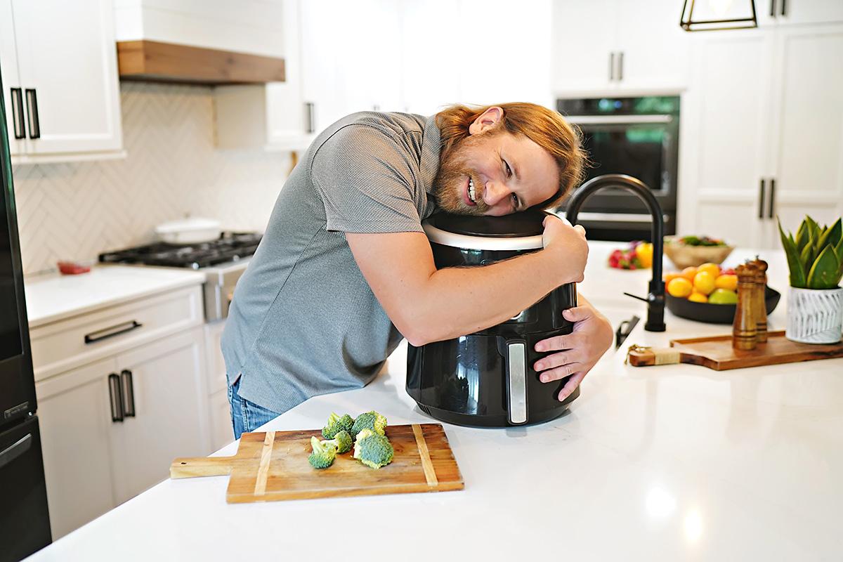 Chad hugging an air fryer.