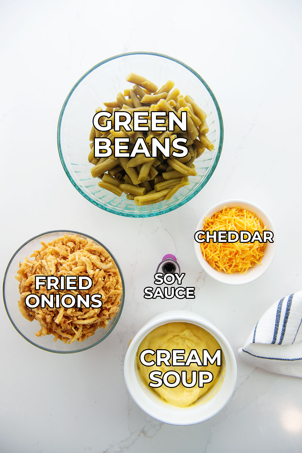 Ingredients for green bean casserole spread out on a countertop.