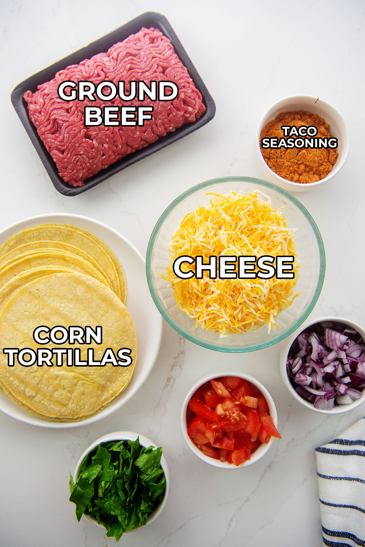Ingredients for fried tacos spread out on a counter.