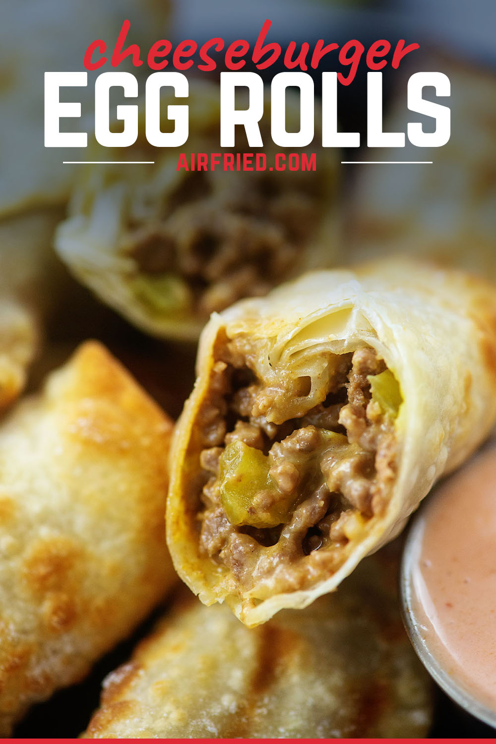 Close up of a stack of cheeseburger egg rolls.