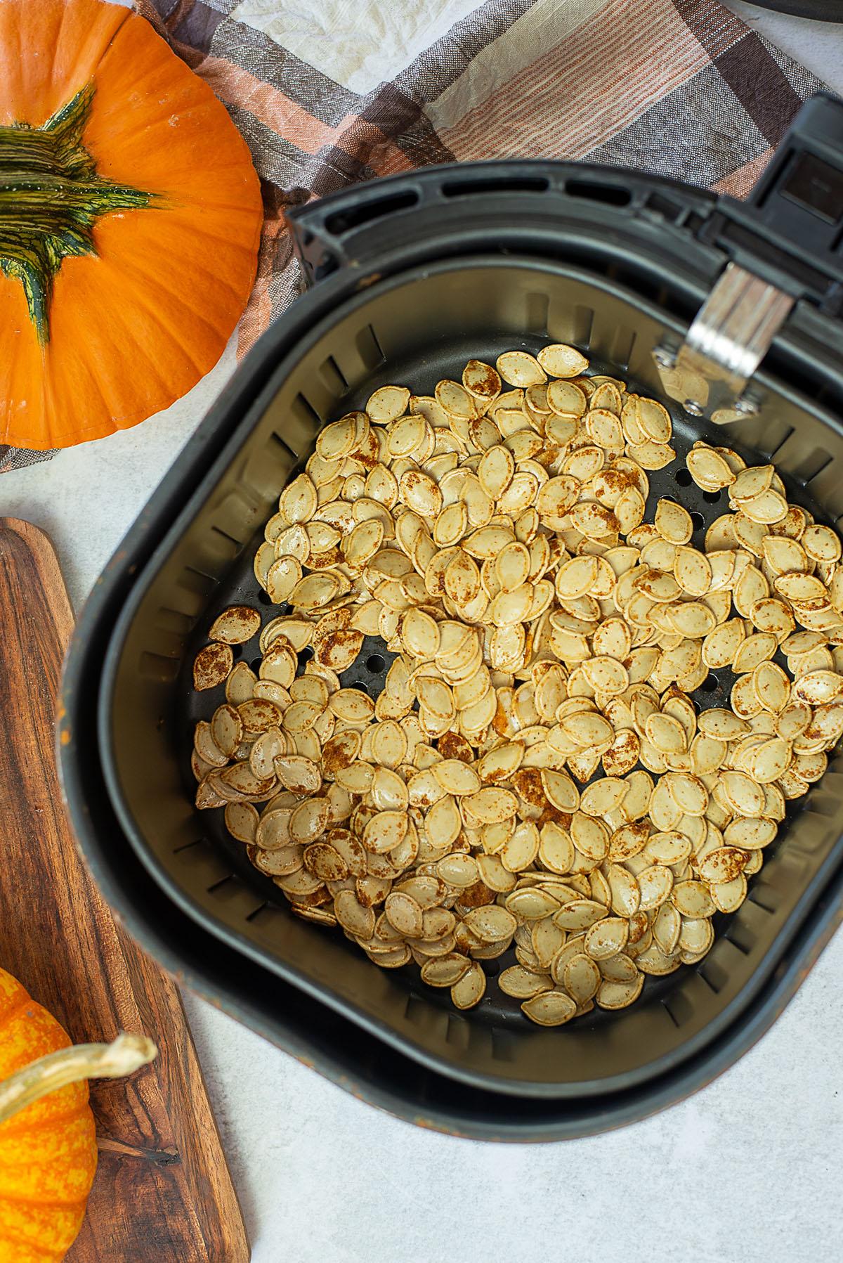 Cooked pumpkin seeds in an air fryer