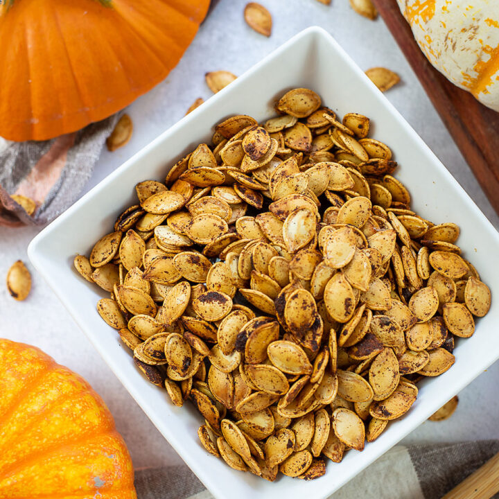 Cooked pumpkin seeds in a square bowl