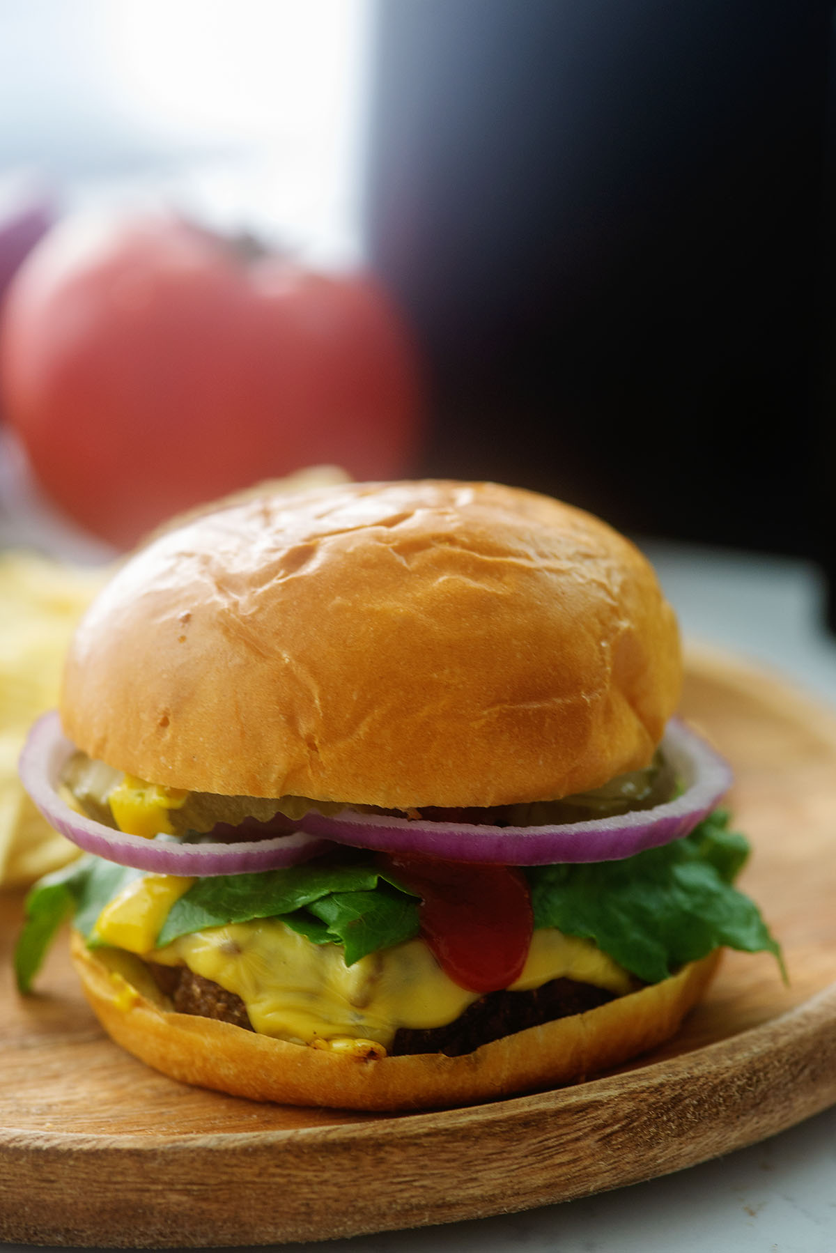 Close up of a cheeseburger with toppings.