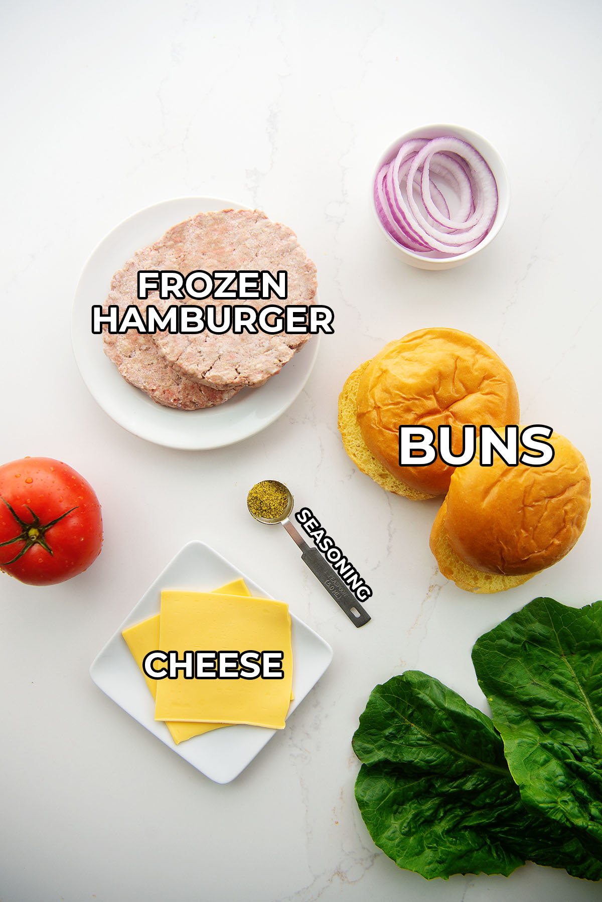 Cheeseburger ingredients spread out on a countertop.